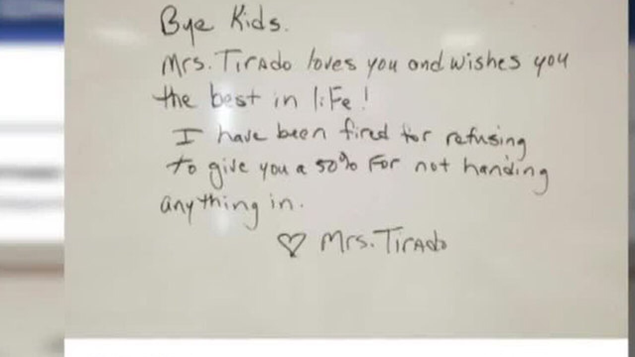 A Florida teacher says she was fired because she didn't give credit to students who didn't do work