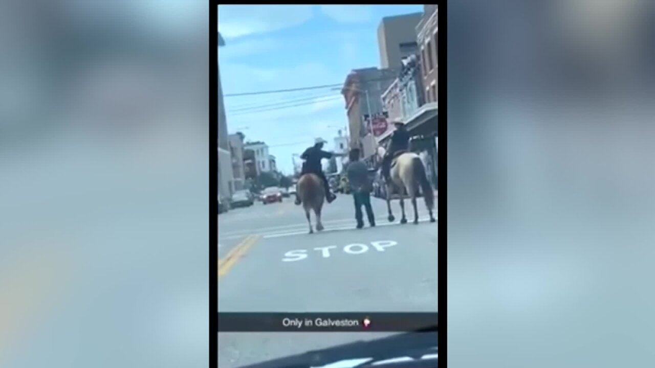 Texas police department apologizes after photos emerge of officers on horseback leading a handcuffed black man