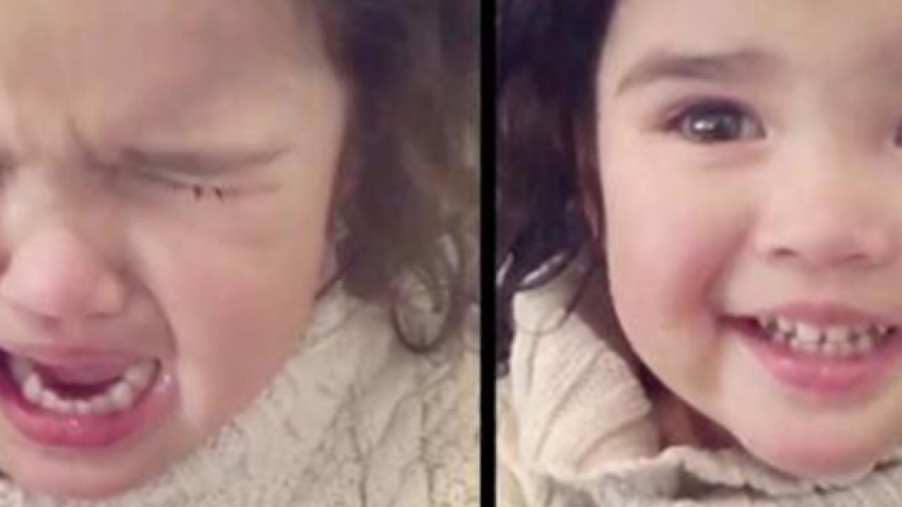 Little girl wipes away tears after mom mentions snacks