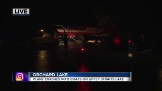 Seaplane crashes into boats on Upper Straits Lake.jpg