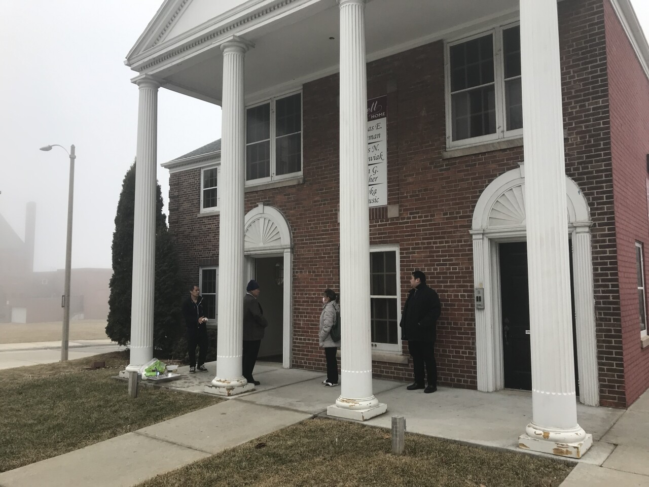Due to the state's ban on indoor public gatherings of 10 or more people, friends and family are forced to wait outside the Brett Funeral Home in Milwaukee for their turn to see their loved one.