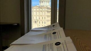 Redistricting commission applications with Michigan capitol.JPG