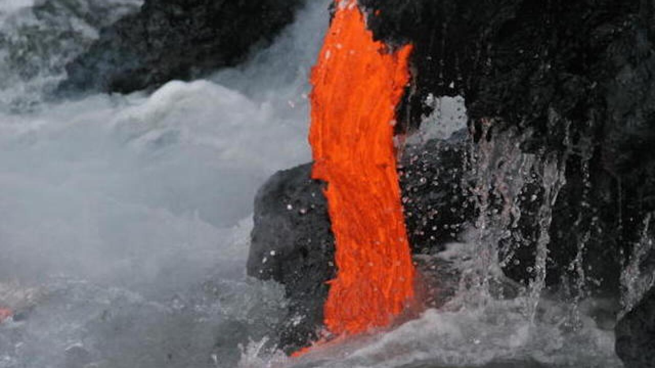 Thousands rush to see Kilauea lava flow reach ocean