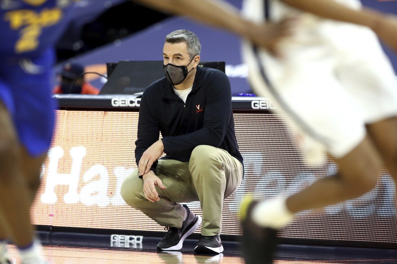 Virginia Cavaliers head coach Tony Bennett watches team from sideline in February 2020