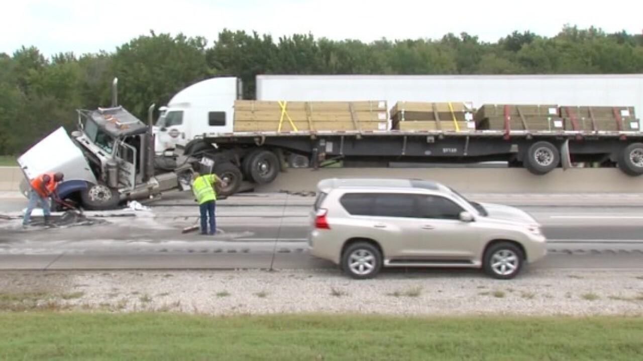Semi truck hits median on Muskogee Turnpike