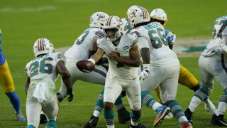 Miami Dolphins QB Tua Tagovailoa hands off to Salvon Ahmed vs. Los Angeles Chargers in 2020