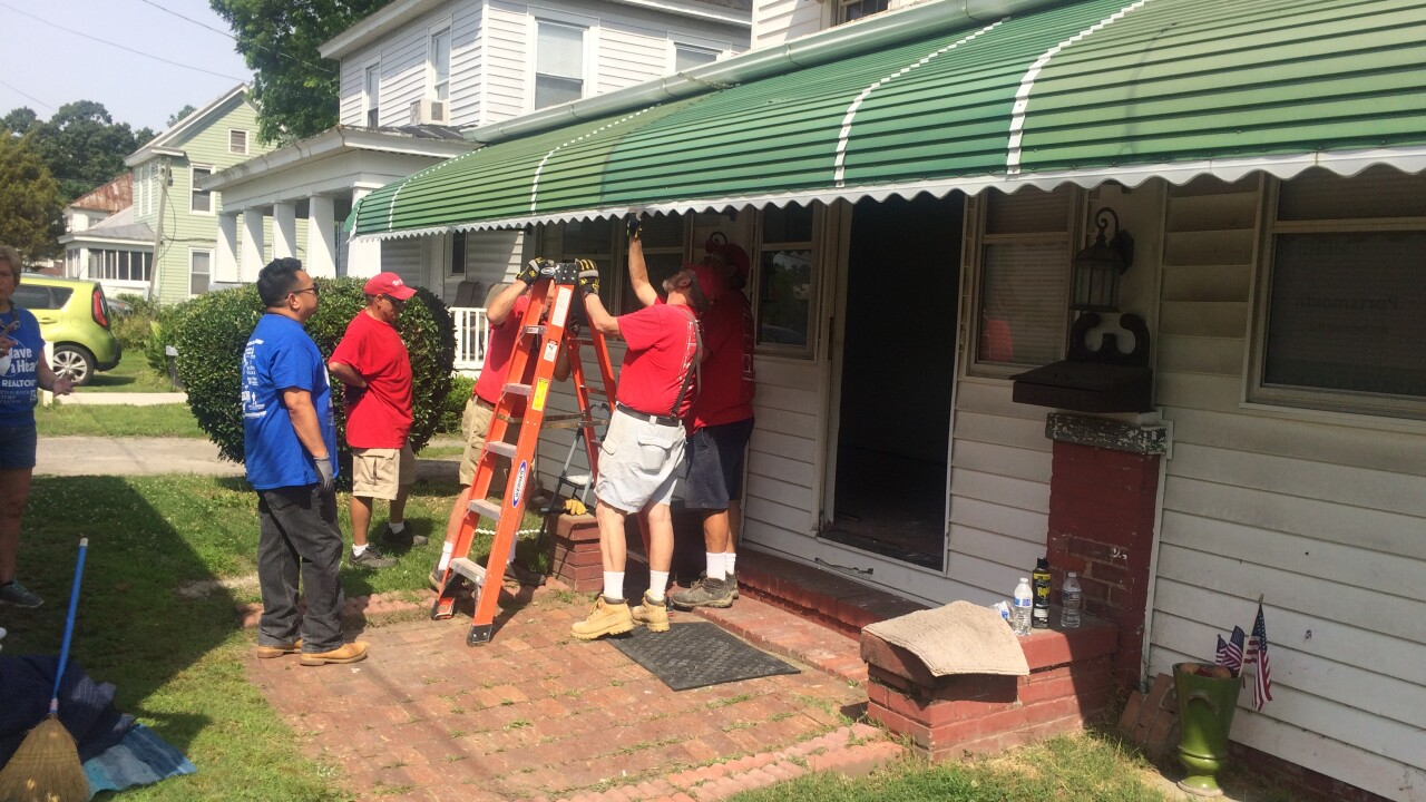 Volunteers take action to repair Gold Star mom's Suffolk home