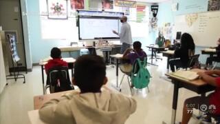 A teacher and students wear face masks inside a Palm Beach County classroom during the 2020_21 school year.jpg