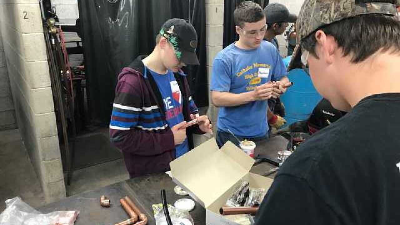 WI students take a crack at the plumbing trade