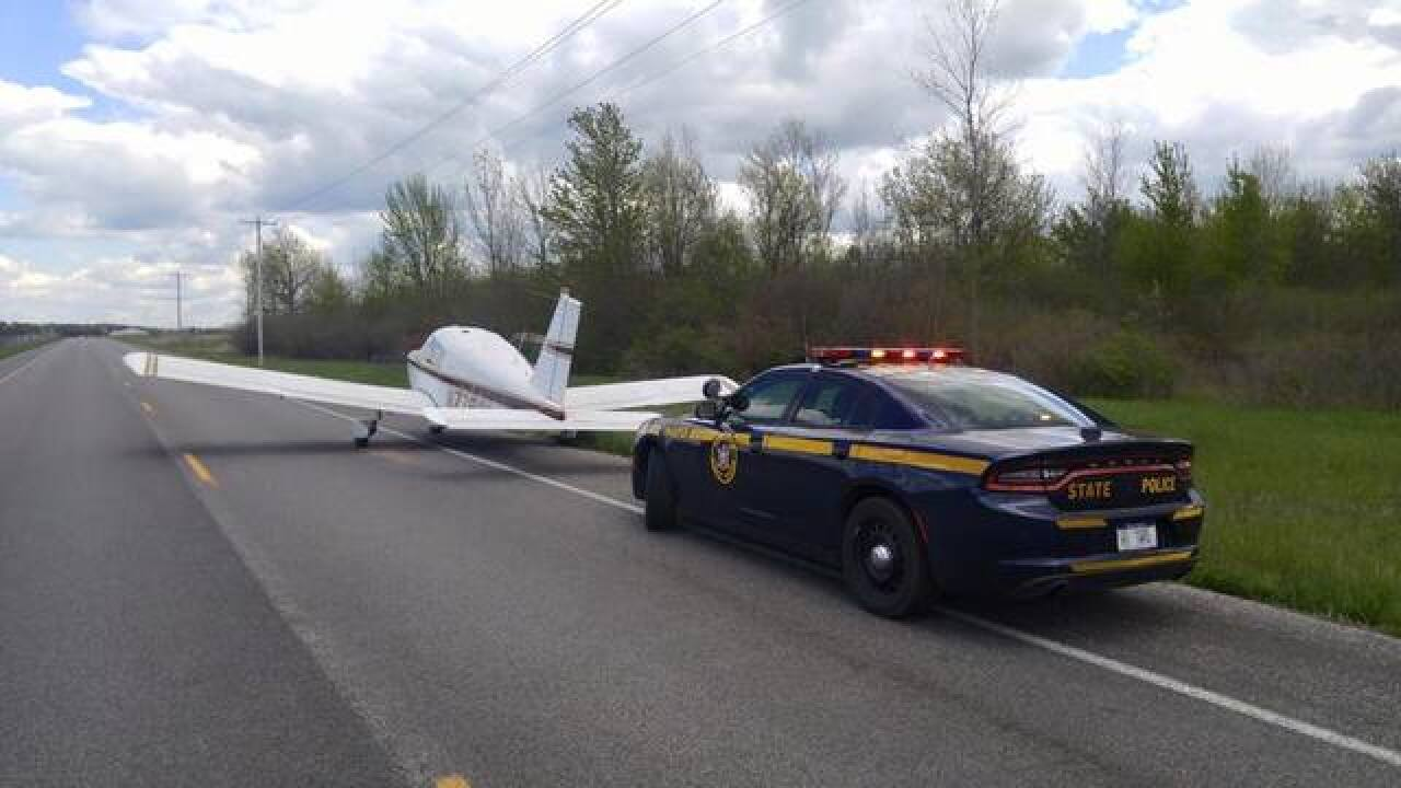 Plane makes emergency landing on roadway