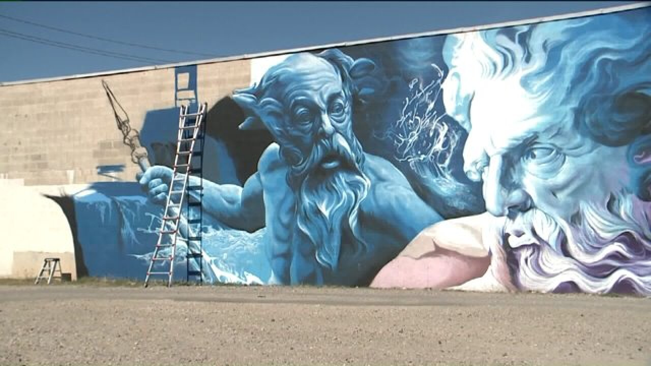 SLC business bothered by graffiti turns to former tagger to create massive mural