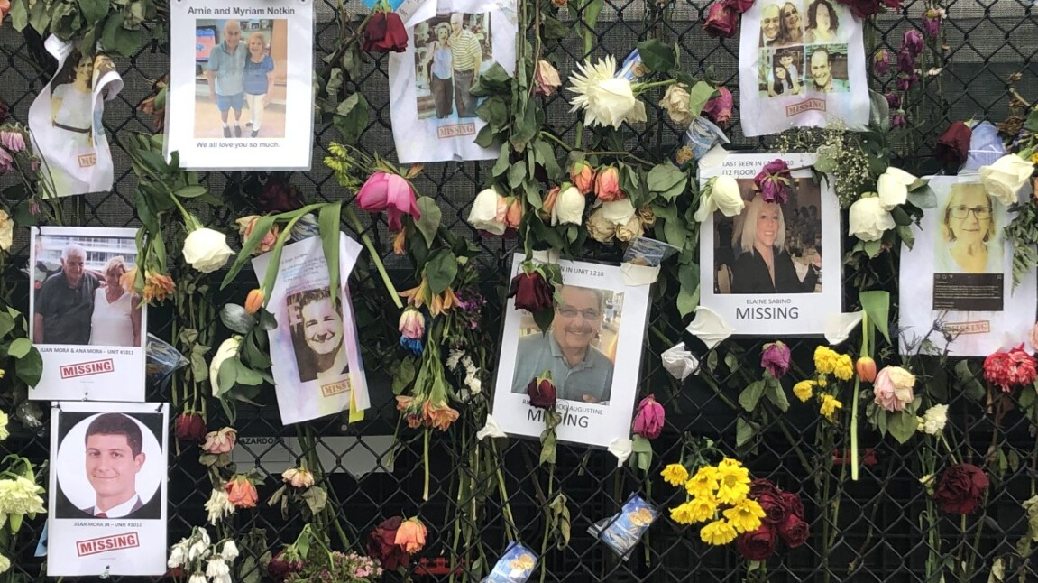 A wall shows photos of dozens of missing people from the Champlain Towers condo collapse on June 28, 2021 (2).jpg