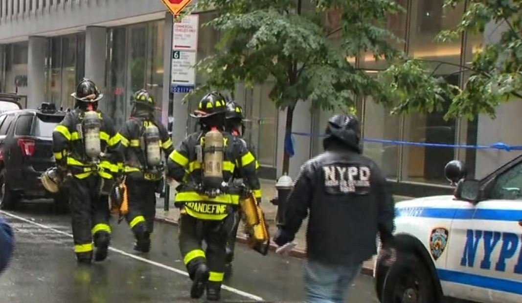 Photos: helicopter makes crash landing on top of New York City building