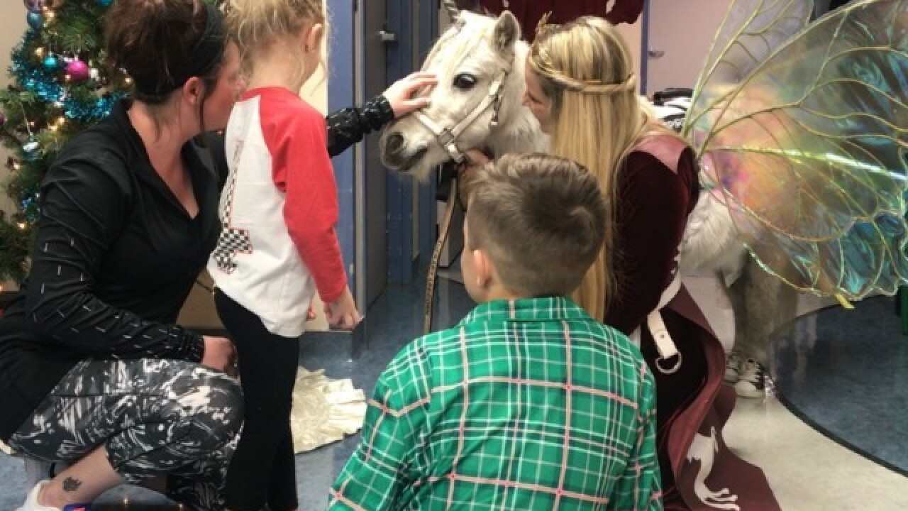 Unicorn brings holiday cheer to children at TGH