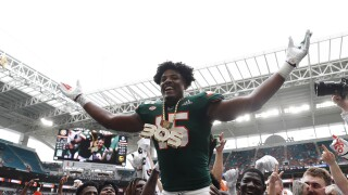 Miami Hurricanes defensive end Gregory Rousseau wears turnover chain in 2019