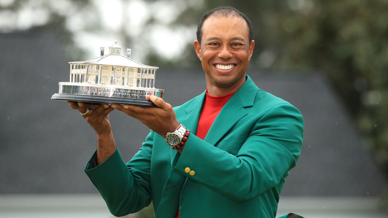 Tiger Woods wins first major title since 2008 in thrilling Masters victory