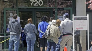 File photo: People line up outside the Utah Department of Workforce Services in Salt Lake City.