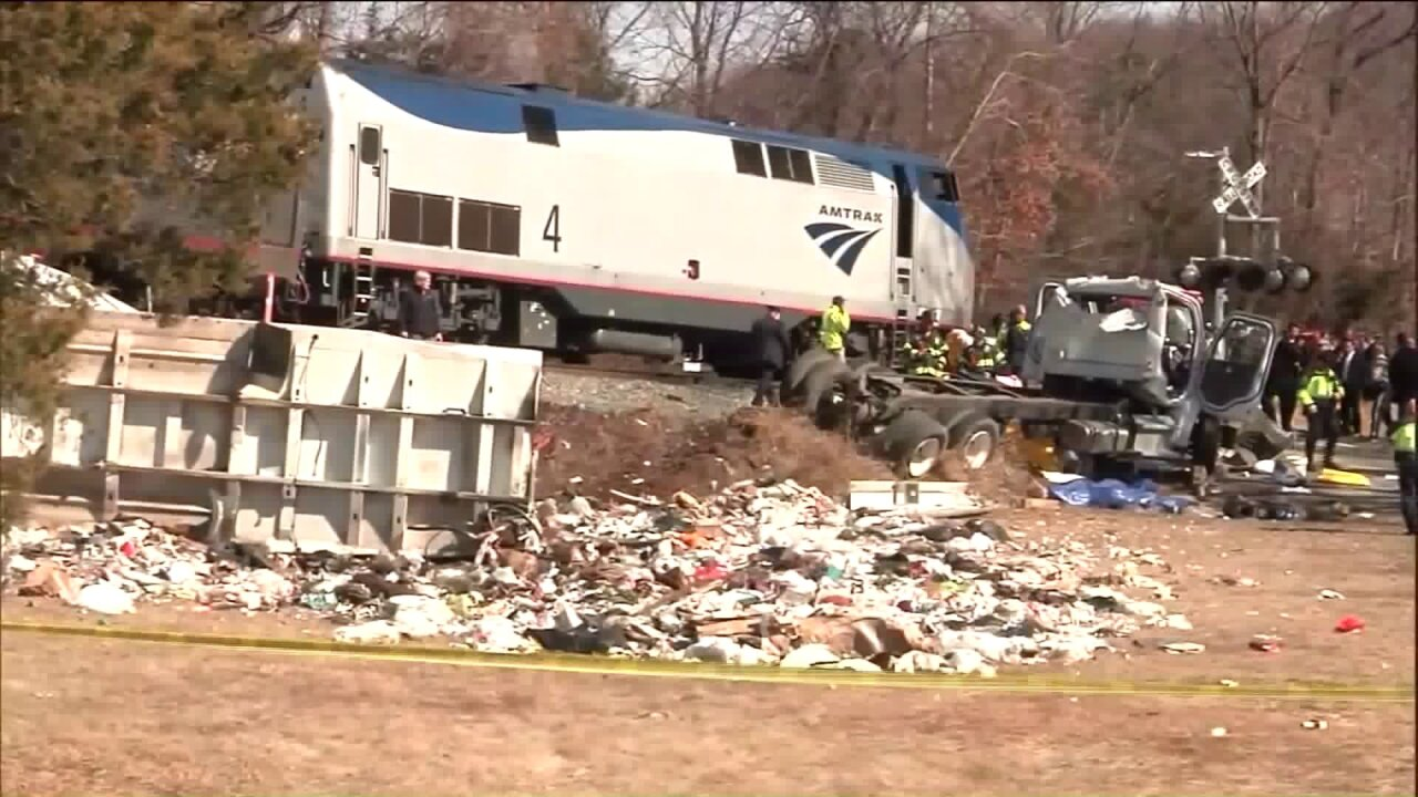 Train carrying members of Congress hits a truck, 1 dead