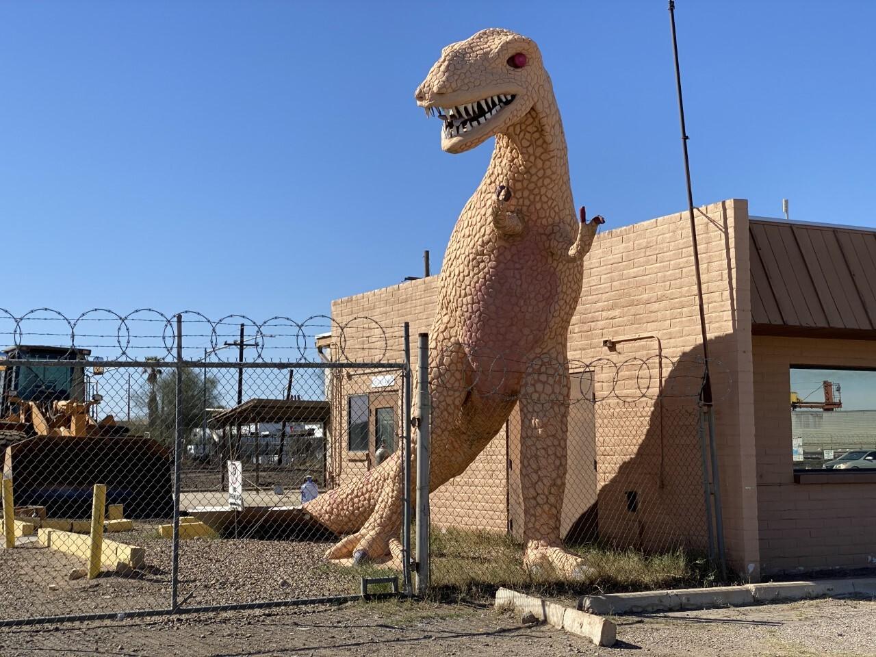Magic Carpet Golf T-Rex statue