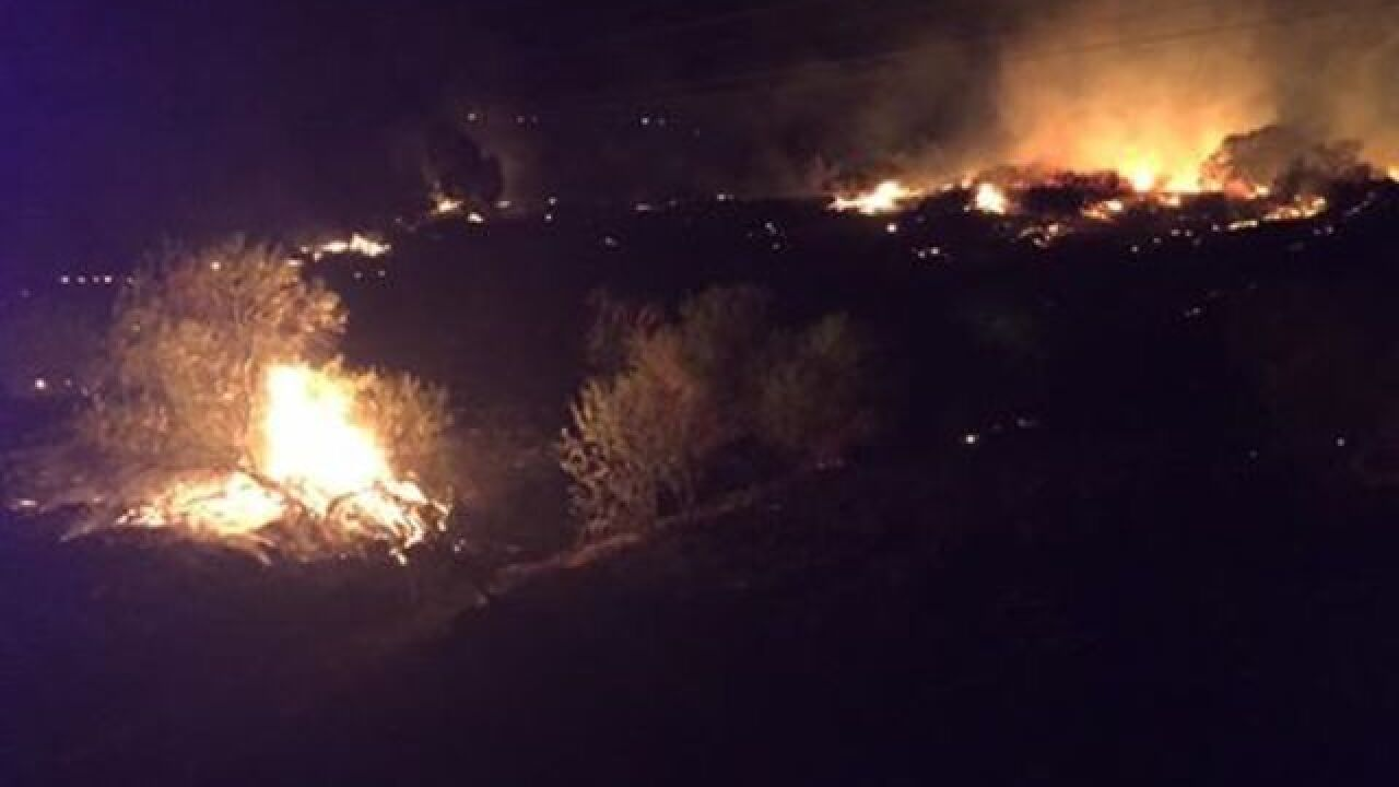 NW firefighters battle two wildfires