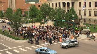Protesters blocking traffic in front of City Hall.