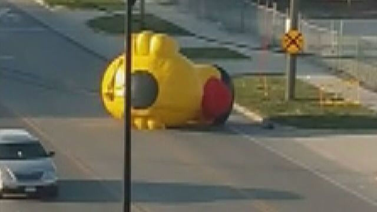 Giant inflatable duck rolls away