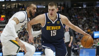 Jokic leads short-handed Nuggets past Jazz 98-95