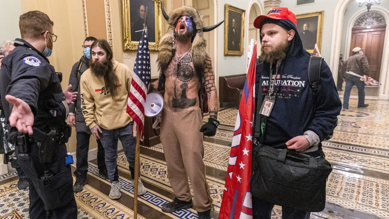A Phoenix man who stormed the U.S. Capitol during the Jan. 6 riot while sporting face paint, no shirt and a furry hat with horns has lost his third bid to be released from jail. AP photo.
