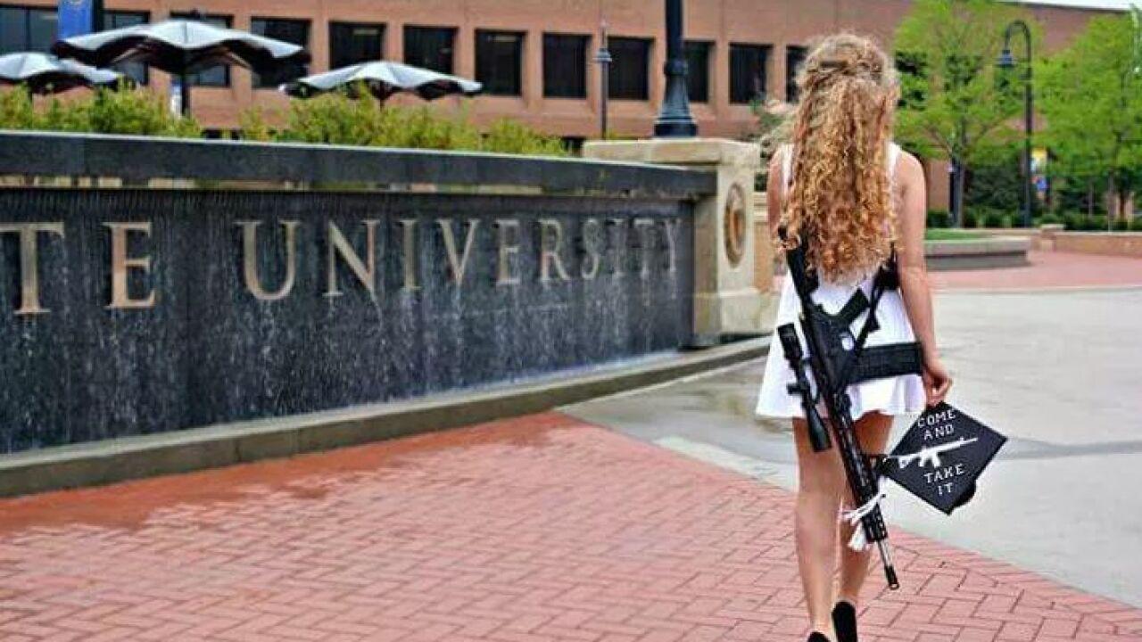 Kent State graduate's gun-toting photo goes viral
