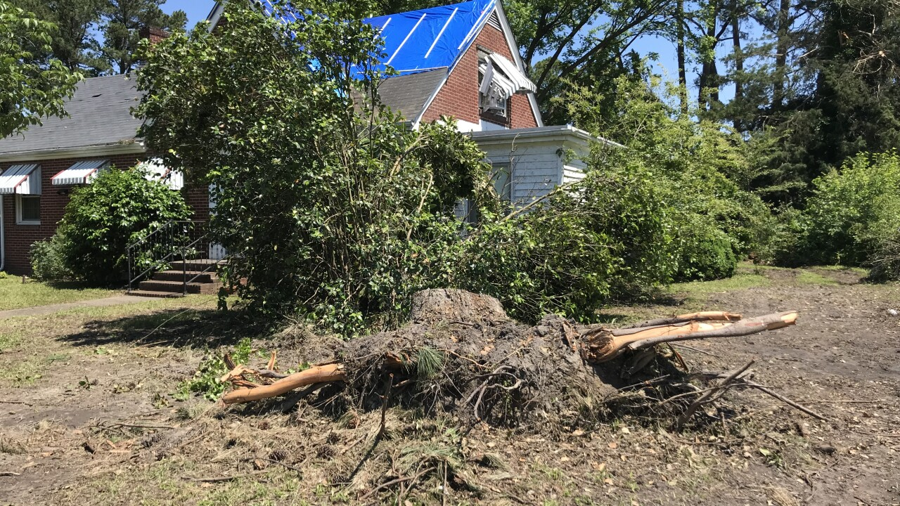 Neighbors cleaning up Suffolk tornado damage warn others to check theirinsurance