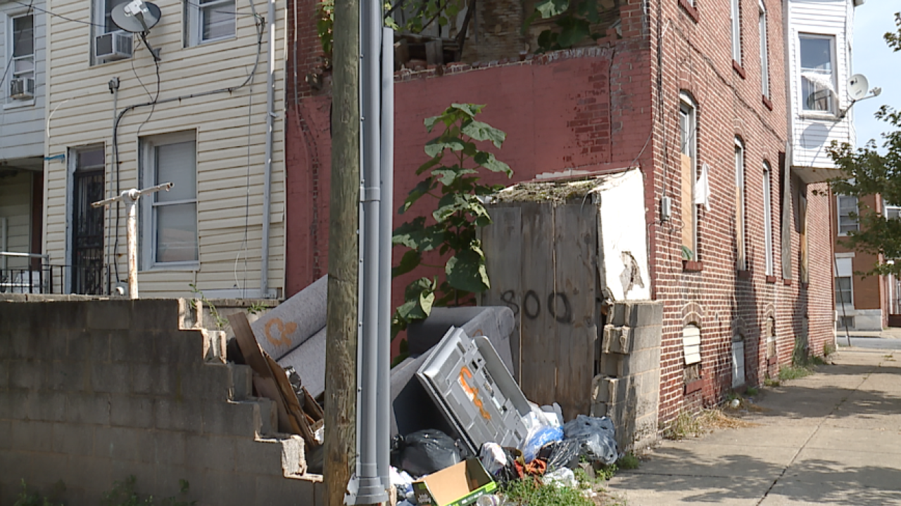 'My eyes are on the sparrow' Neighbors target vacant property that's turned into a trash pad