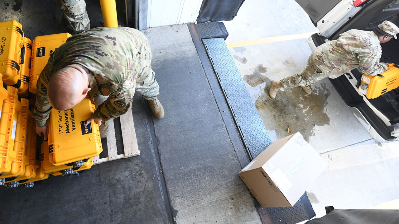 Pvt. 1st Class Delante Adkinson, a Louisiana National Guardsman from Austin, Texas with the 139th Regional Support group, packages and ships ventilator equipment in support of the state and federal COVID-19 response in Baton Rouge, Louisiana, April 1, 2020. (U.S. Army National Guard photo by Staff Sgt. Garrett L. Dipuma)