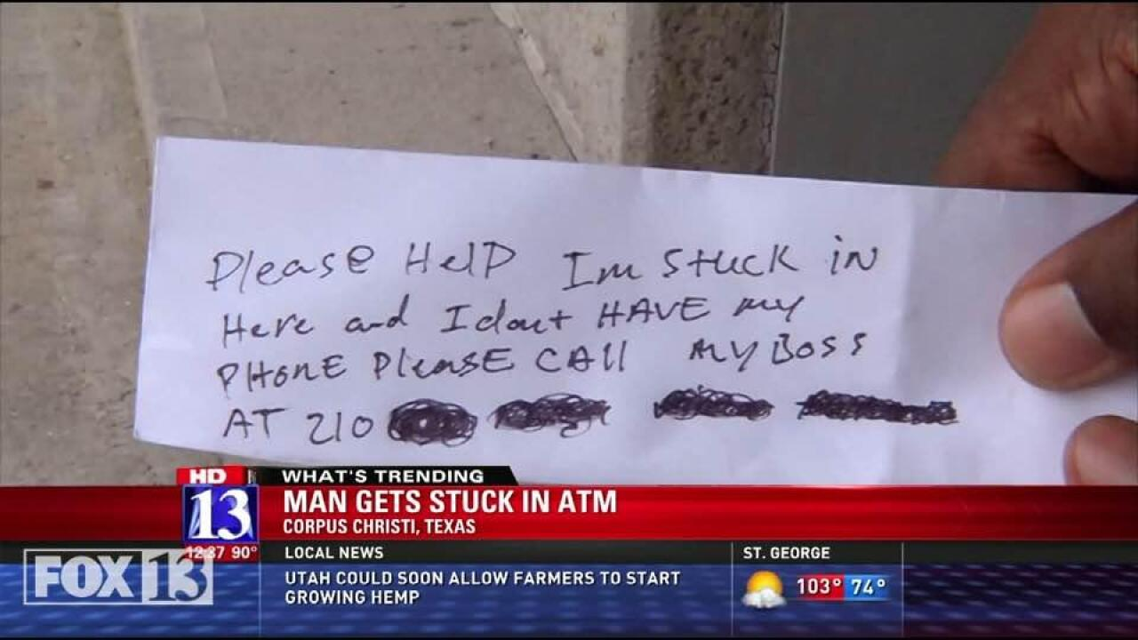 Man trapped in ATM slips notes to customers begging forhelp