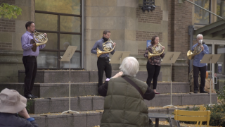 With stages shuttered, orchestras move to street corner performances
