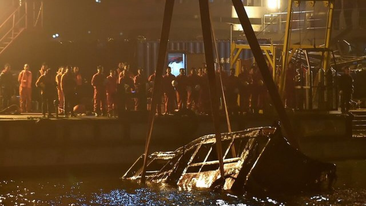 China bus plunged off bridge after woman attacked driver