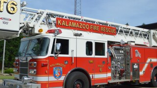 Business heavily damaged in a fire, firefighter injured