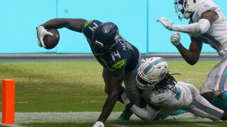 Miami Dolphins safety Bobby McCain tries to tackle Seattle Seahawks receiver DK Metcalf in 2020