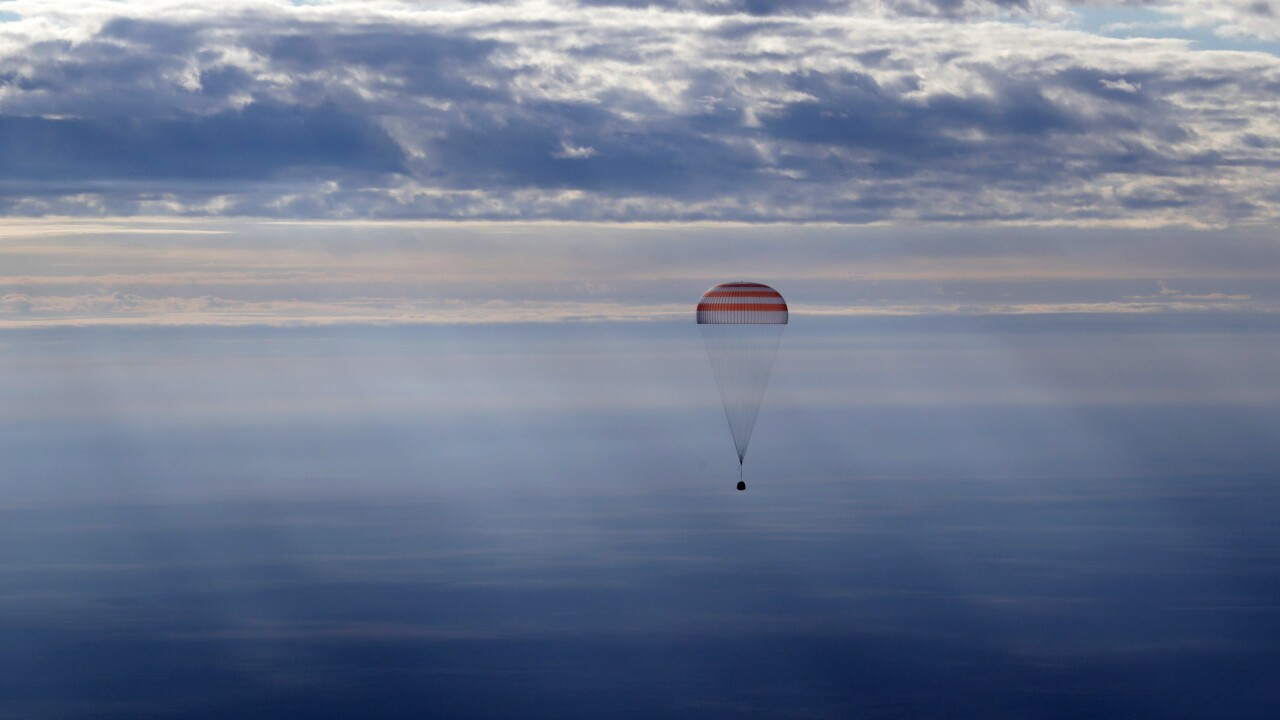 Three International Space Station crew members return safely to Earth
