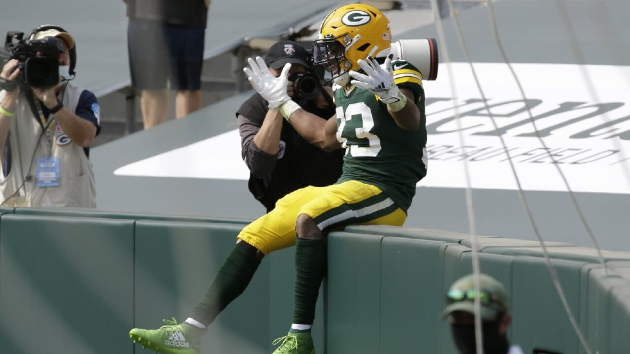Aaron Jones celebrates touchdown Packers vs Lions.jpeg