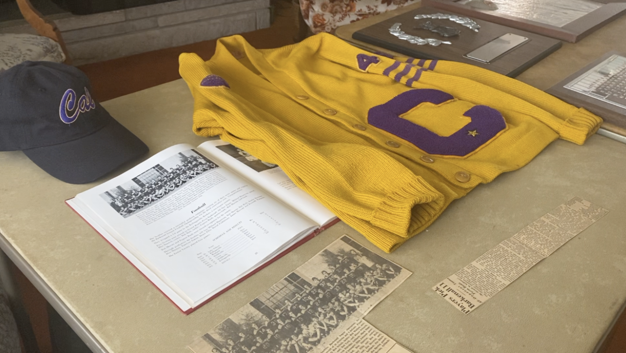 Eugene Raab's Caledonia football sweater, press clippings