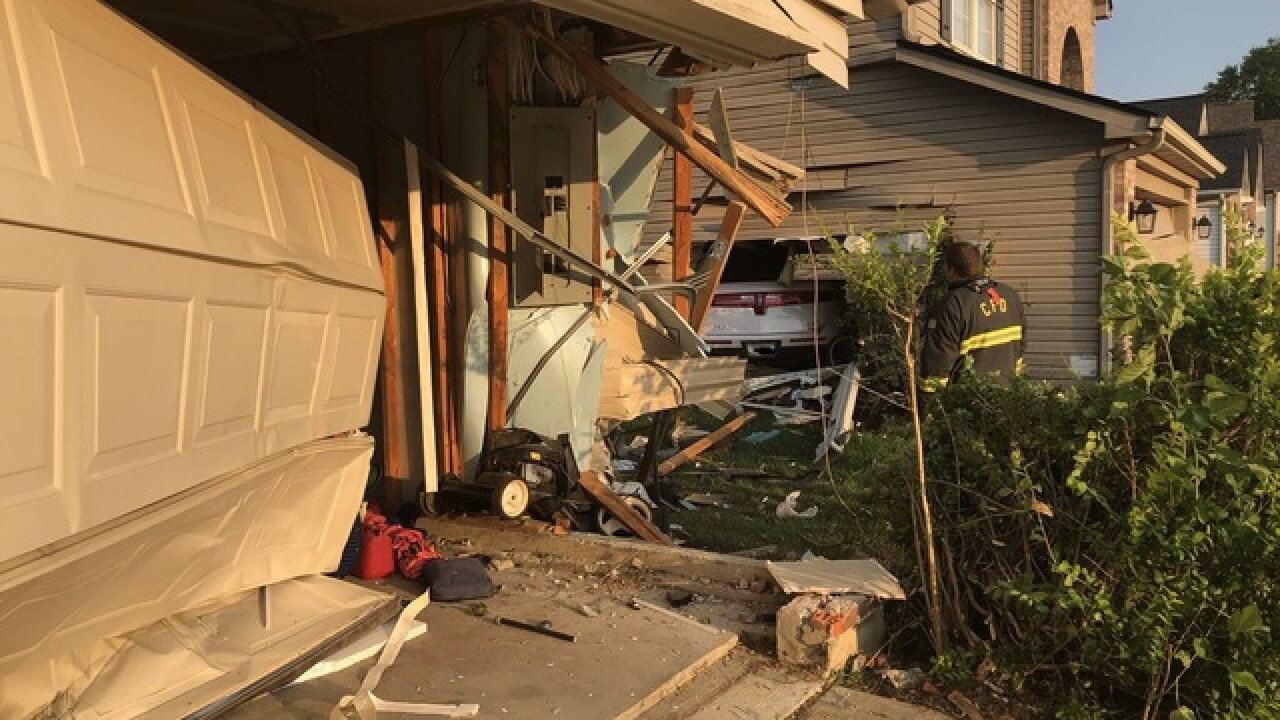 Car crashes into two garages in Carmel