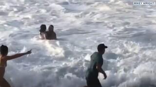 Surfer saves woman