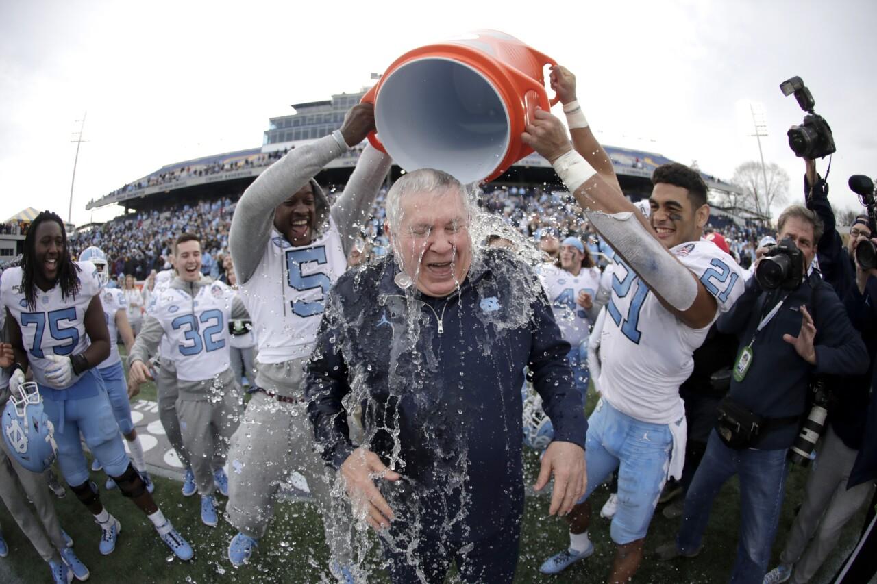 North Carolina Tar Heels head coach Mack Brown gets Gatorade shower after 2019 Military Bowl win