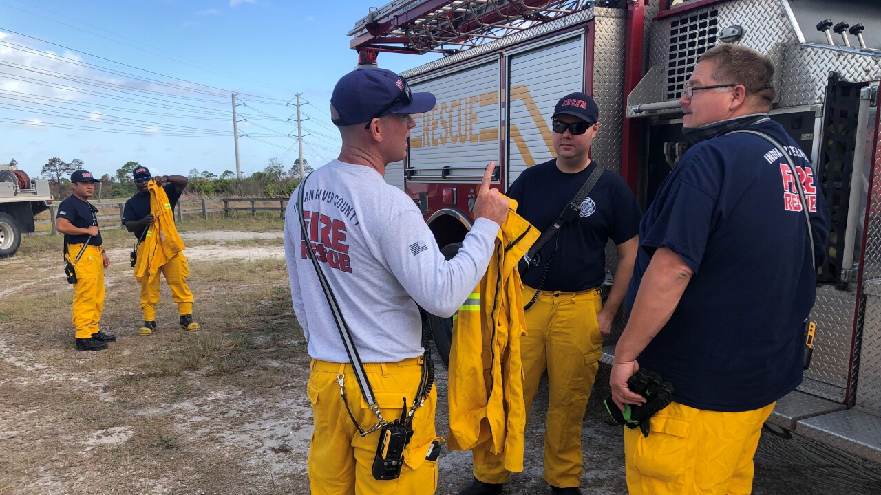 The Florida Fire Service says a preliminary investigation has determined Friday's 1,600-acre wildfire was caused by an unattended campfire left in the park by someone on Thursday evening.
