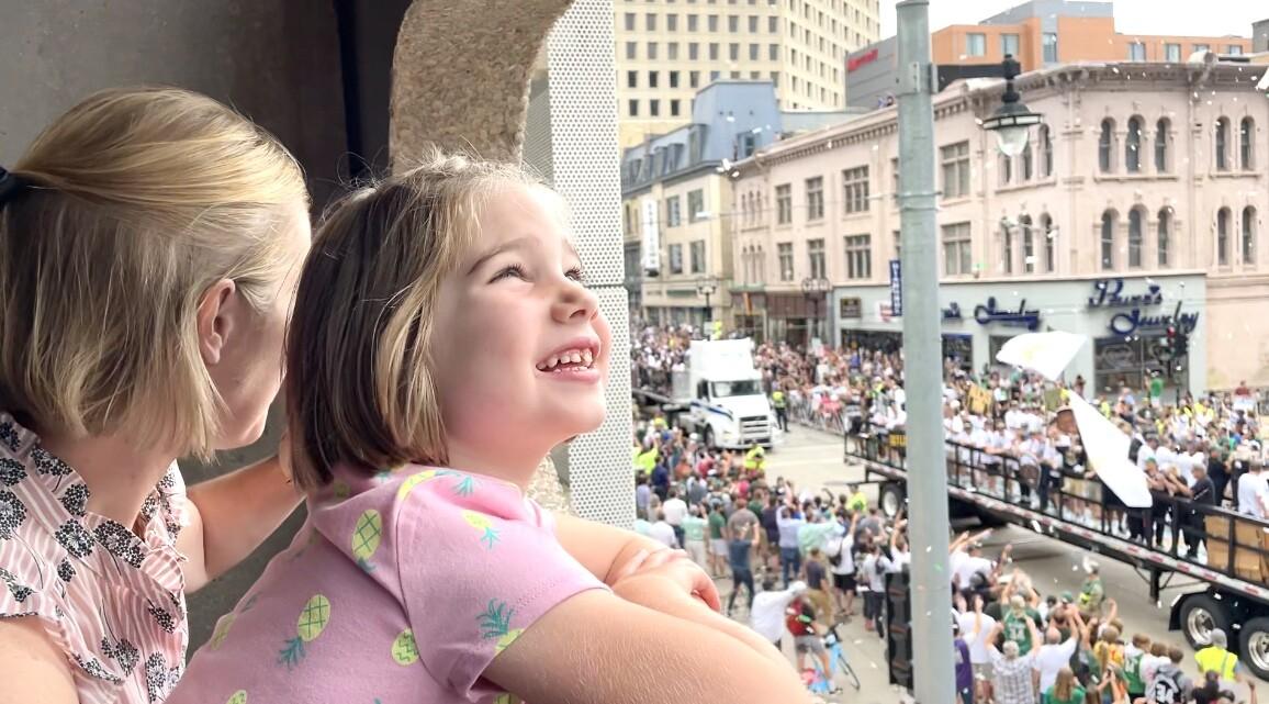 Bucks parade little girl watches .jpg
