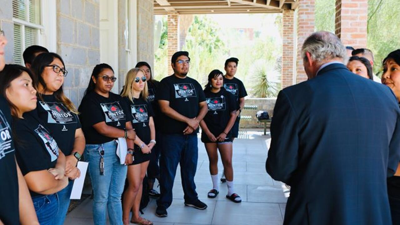 President Robbins speaks to Native SOAR group outside Old Main on Oct. 3.