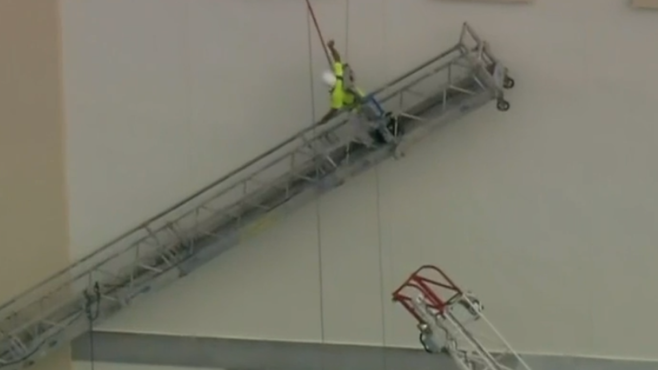 Watch: Construction worker rescued by firefighters from side of Florida building