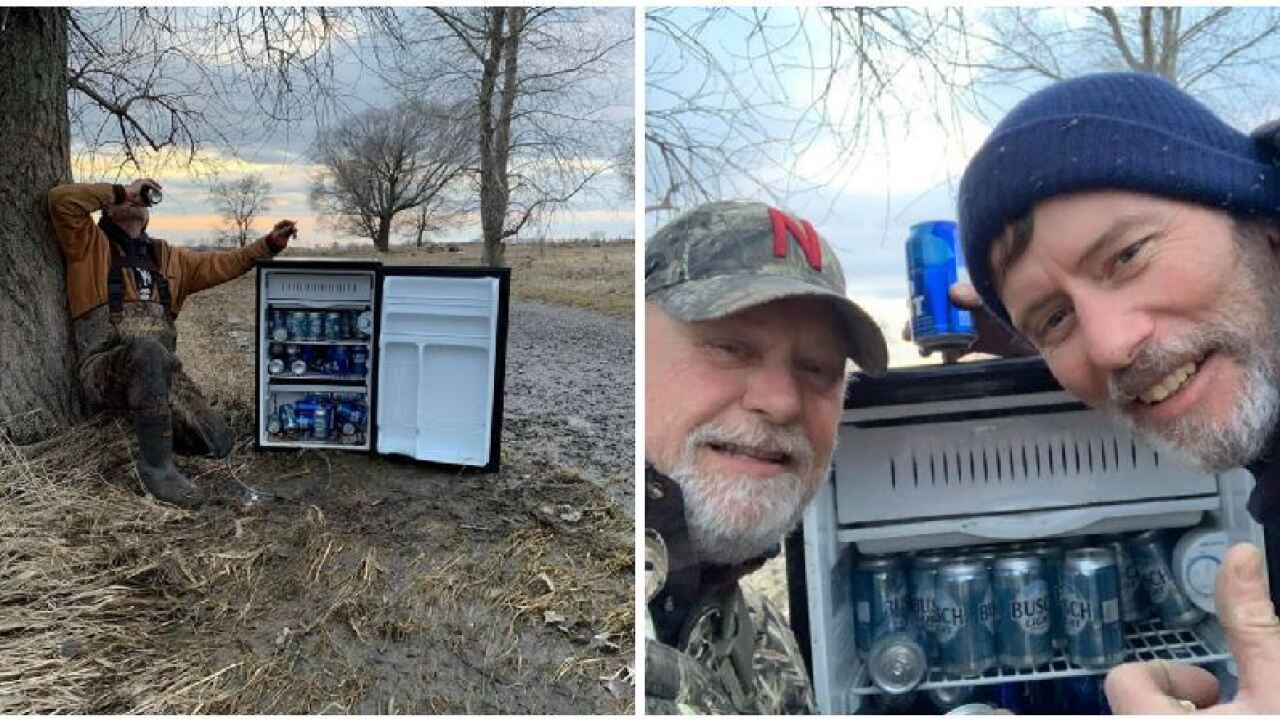 Men find 'magic fridge' full of ice cold beer in flooded field