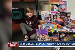 Third-grader brings holiday joy to toy drive