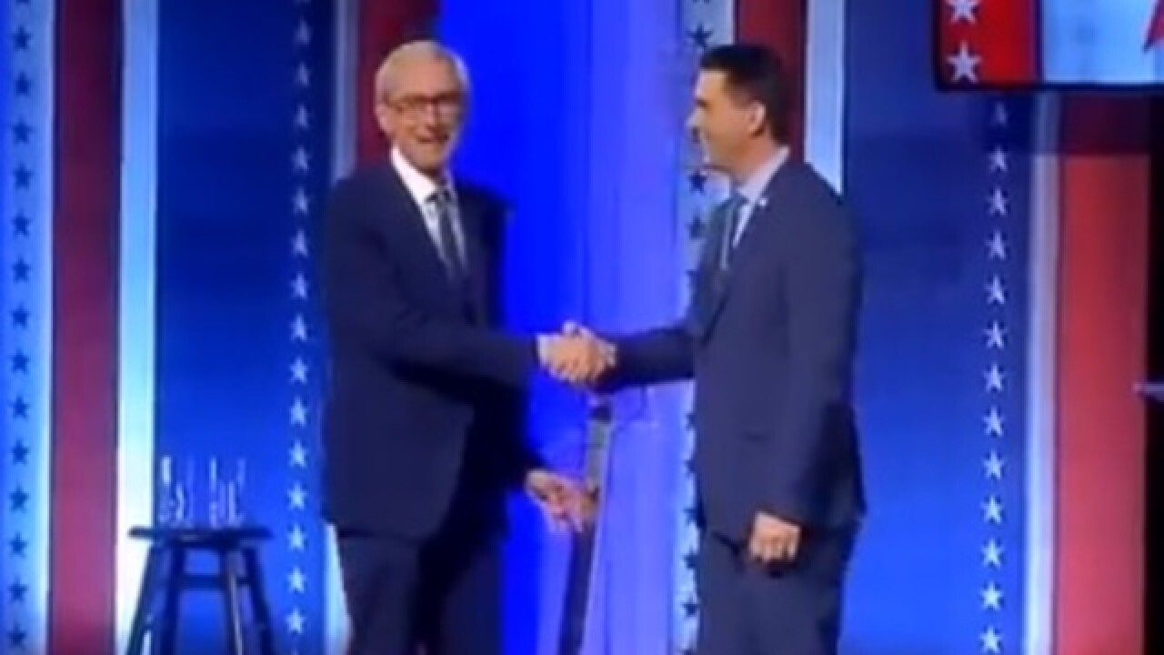 Evers, Walker address divide during debate